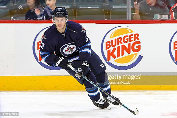 Tobias Enstrom of the Winnipeg Jets takes part in the pregame warm up prior to NHL action against the New York Islanders at the MTS Centre on March 4...