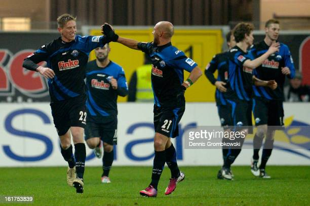 Tobias Feisthammel of Paderborn celebrates with teammate Daniel Brueckner after scoring his team's first goal during the Second Bundesliga match...