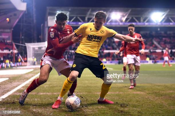 Tobias Figueiredo of Nottingham Forest abd Jón Dadi Bödvarsson of Millwall in action during the Sky Bet Championship match between Nottingham Forest...