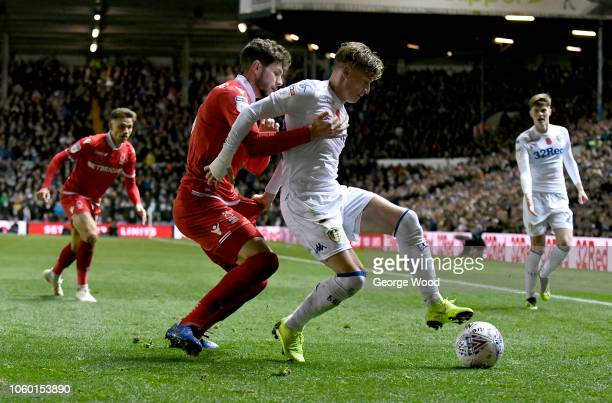 Tobias Figueiredo of Nottingham Forest competes for the ball with Ezgjan Alioski of Leeds United during the Sky Bet Championship between Leeds United...