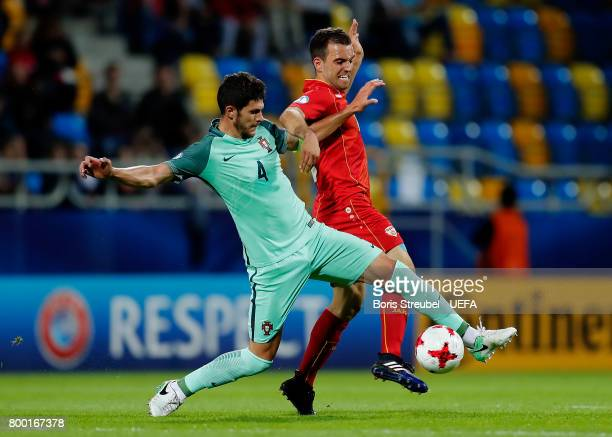Tobias Figueiredo of Portugal battles for the ball with Viktor Angelov of FYR Macedonia during the UEFA European Under21 Championship Group B match...