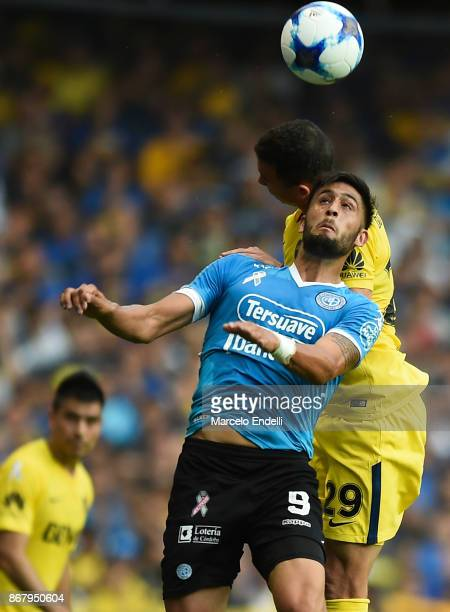 Tobias Figueroa of Belgrano fights for the ball with Leonardo Jara of Boca Juniors during a match between Boca Juniors and Belgrano as part of...