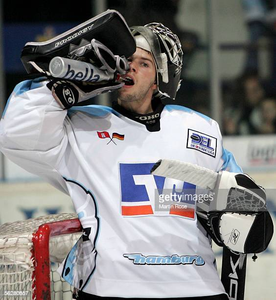 Tobias Guettner goalkeeper of Hamburg takes a refreshment during the DEL Bundesliga match between Iserlohn Roosters and Hamburg Freezers on November...