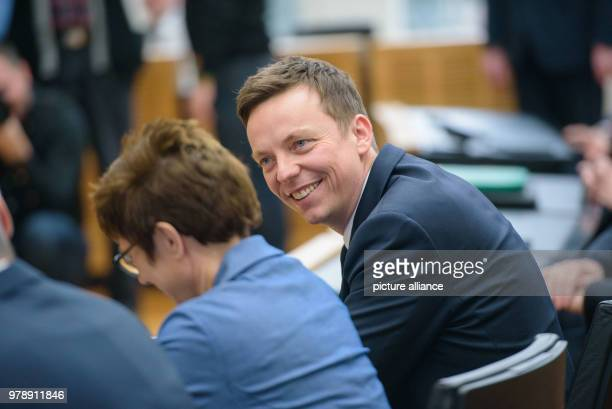 Tobias Hans the Saarland's new premier sitting next to his predecessor Annegret KrampKarrenbauer who is moving to Berlin as the CDU's new secretary...