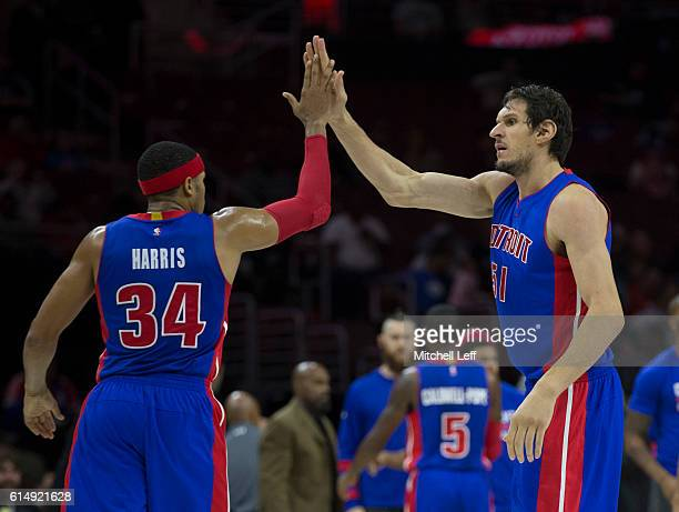Tobias Harris and Boban Marjanovic of the Detroit Pistons high five each other during a timeout in the second half against the Philadelphia 76ers at...