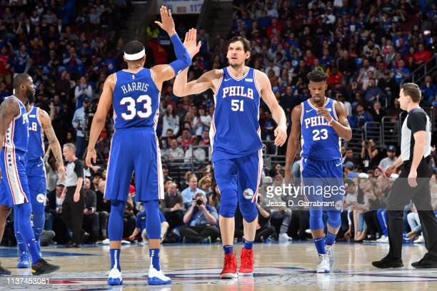 Tobias Harris and Boban Marjanovic of the Philadelphia 76ers highfive during a game against the Brooklyn Nets during Game Two of Round One of the...