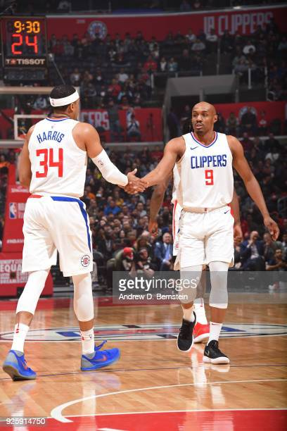 Tobias Harris and CJ Williams of the LA Clippers shake hands during the game against the Houston Rockets on February 28 2018 at STAPLES Center in Los...