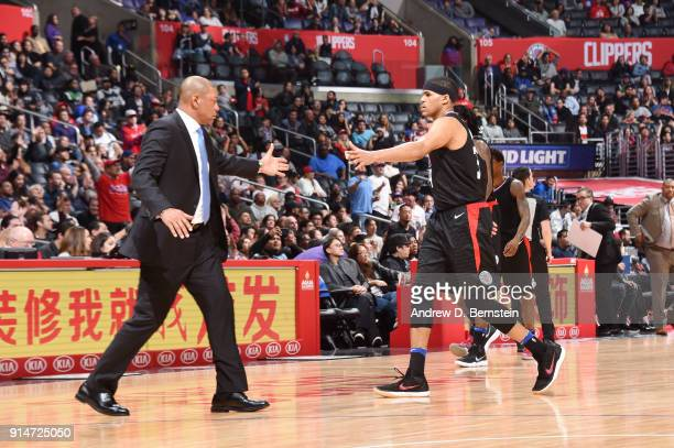 Tobias Harris and Head Coach Doc Rivers of the LA Clippers high five during the game against the Dallas Mavericks on February 5 2018 at STAPLES...