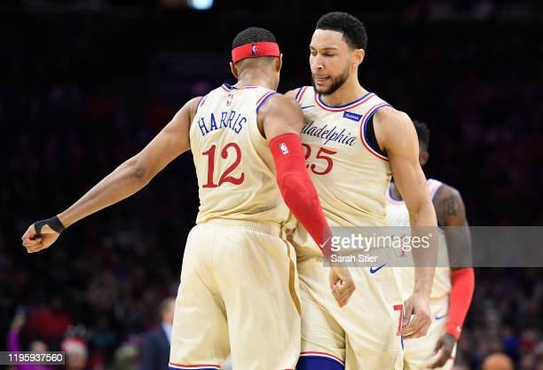 Tobias Harris chestbumps Ben Simmons of the Philadelphia 76ers during the first half of the game against the Milwaukee Bucks at Wells Fargo Center on...