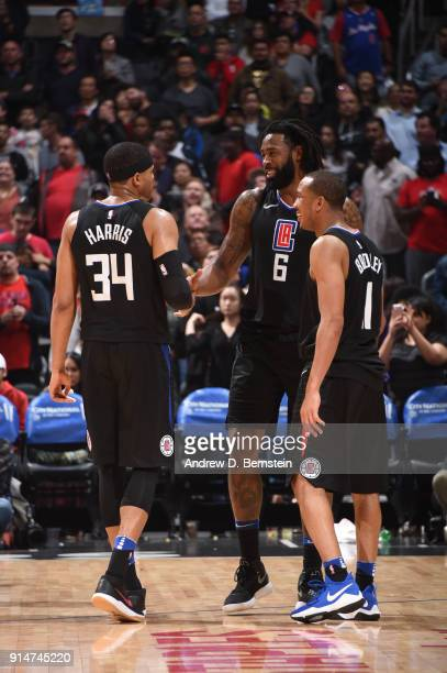 Tobias Harris DeAndre Jordan and Avery Bradley of the LA Clippers talk after the game against the Dallas Mavericks on February 5 2018 at STAPLES...