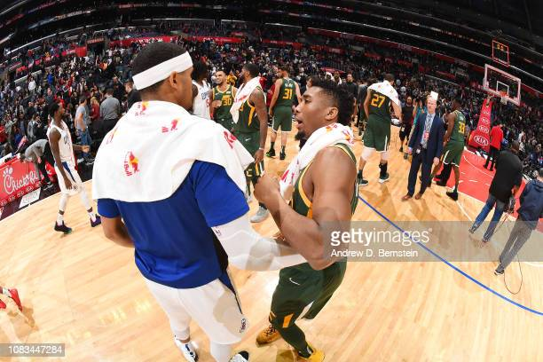 Tobias Harris of the LA Clippers and Donovan Mitchell of the Utah Jazz hug after the game on January 16 2019 at STAPLES Center in Los Angeles...