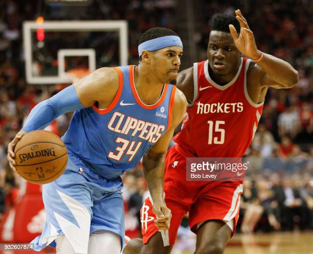 Tobias Harris of the LA Clippers drives past Clint Capela of the Houston Rockets for a layup at Toyota Center on March 15 2018 in Houston Texas NOTE...