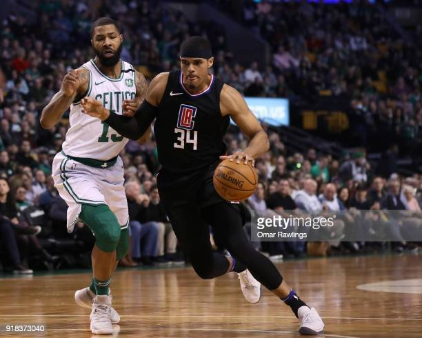 Tobias Harris of the LA Clippers drives to the basket against Marcus Morris of the Boston Celtics during the first quarter of the game at TD Garden...