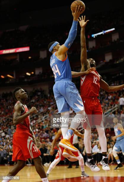 Tobias Harris of the LA Clippers floats a shot over Luc Mbah a Moute of the Houston Rockets as Clint Capela looks on in the fourth quarter at Toyota...