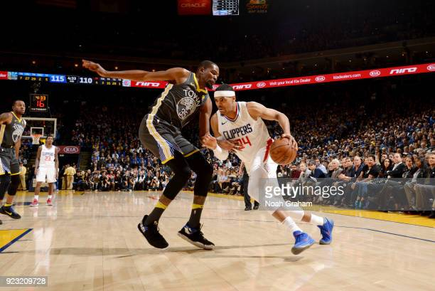 Tobias Harris of the LA Clippers handles the ball against the Golden State Warriors on February 22 2018 at ORACLE Arena in Oakland California NOTE TO...