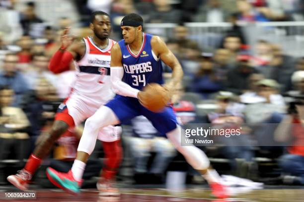 Tobias Harris of the LA Clippers is defended by John Wall of the Washington Wizards during the second half at Capital One Arena on November 20, 2018...