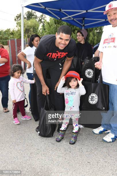 Tobias Harris of the LA Clippers poses for a photo with a fan on October 13 2018 at the Salvation Army Siemon Family Youth Community Center in Los...