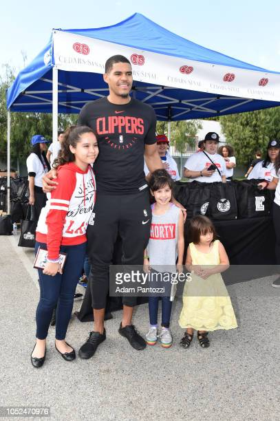 Tobias Harris of the LA Clippers poses for a photo with fans on October 13 2018 at the Salvation Army Siemon Family Youth Community Center in Los...