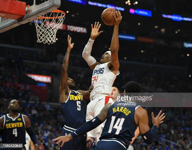 Tobias Harris of the LA Clippers shoots over Will Barton of the Denver Nuggets in the first half during the season opening game at Staples Center on...