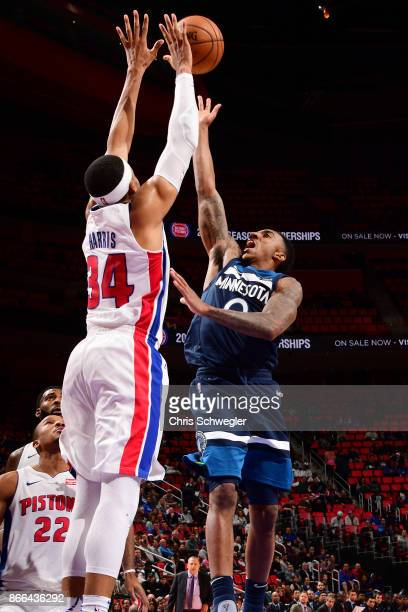 Tobias Harris of the Detroit Pistons and Jeff Teague of the Minnesota Timberwolves vie for the ball during the game on October 25, 2017 at Little...