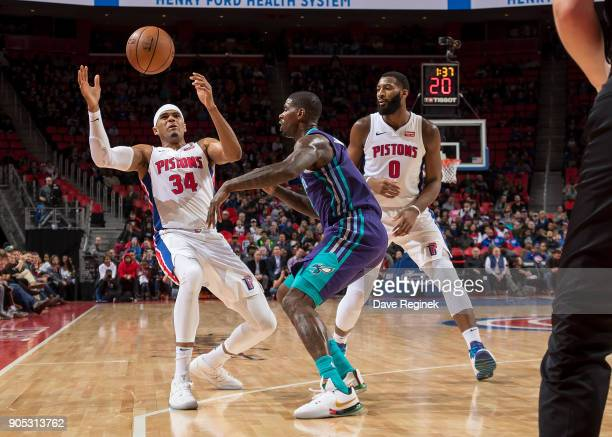 Tobias Harris of the Detroit Pistons battles for a loose ball with Marvin Williams of the Charlotte Hornets in the second half during the an NBA game...