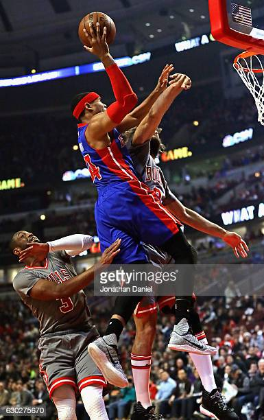 Tobias Harris of the Detroit Pistons goes up for a shot over Dwyane Wade and Robin Lopez of the Chicago Bulls at the United Center on December 19...