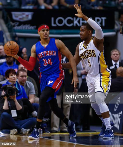 Tobias Harris of the Detroit Pistons passes the ball off as Lavoy Allen of the Indiana Pacers defends at Bankers Life Fieldhouse on March 8 2017 in...