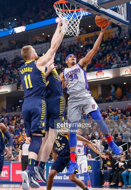 Tobias Harris of the Detroit Pistons shoots the ball against TJ Leaf of the Indiana Pacers at Bankers Life Fieldhouse on December 15 2017 in...