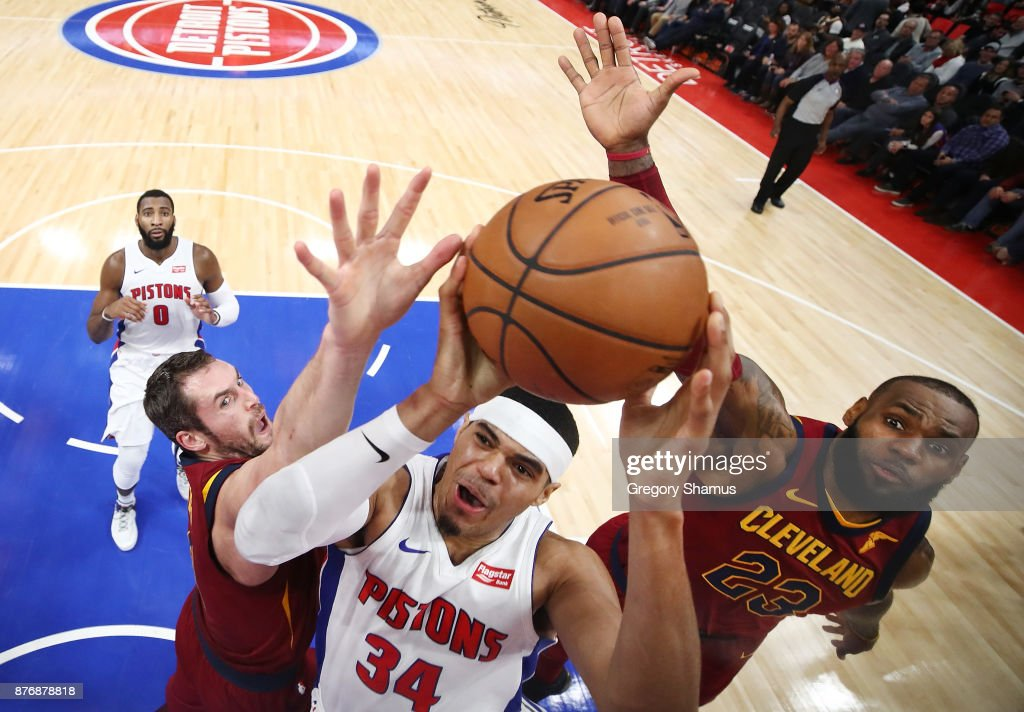 Tobias Harris #34 of the Detroit Pistons splits the defense of LeBron James #23 and Kevin Love #0 of the Cleveland Cavaliers during the second half at Little Caesars Arena on November 20, 2017 in Detroit, Michigan.