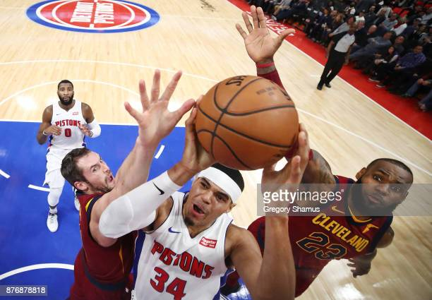 Tobias Harris of the Detroit Pistons splits the defense of LeBron James and Kevin Love of the Cleveland Cavaliers during the second half at Little...