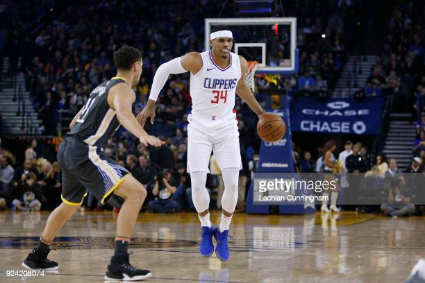 Tobias Harris of the Los Angeles Clippers dribbles the ball against Klay Thompson of the Golden State Warriors at ORACLE Arena on February 22 2018 in...