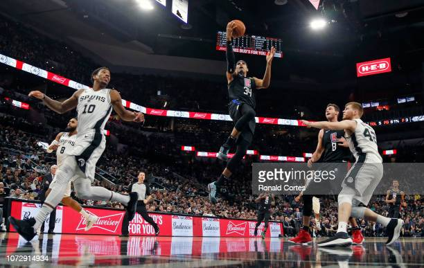 Tobias Harris of the Los Angeles Clippers drives for a layup against the San Antonio Spurs at ATT Center on December 13 2018 in San Antonio Texas...