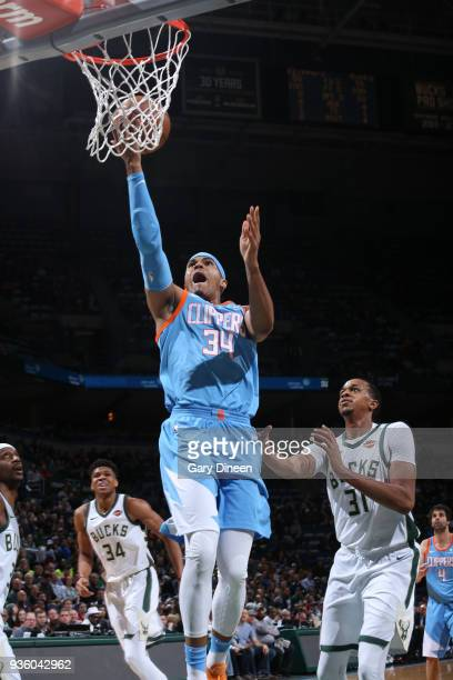 Tobias Harris of the Los Angeles Clippers shoots against John Henson of the Milwaukee Bucks during the NBA game on March 21 2018 at the BMO Harris...