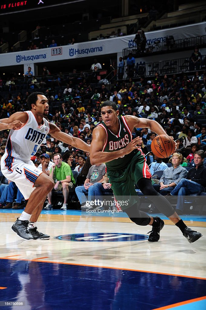 Tobias Harris #15 of the Milwaukee Bucks drives to the basket against Gerald Henderson #9 of the Charlotte Bobcats at the Time Warner Cable Arena on October 25, 2012 in Charlotte, North Carolina.