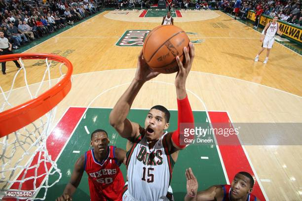 Tobias Harris of the Milwaukee Bucks shoots a layup against Lavoy Allen and Evan Turner of the Philadelphia 76ers during the game on March 5 2012 at...