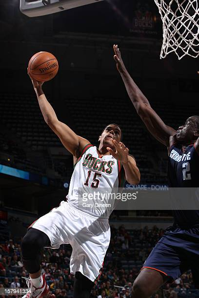 Tobias Harris of the Milwaukee Bucks shoots against DeSagana Diop of the Charlotte Bobcats during the game on December 7 2012 at the BMO Harris...