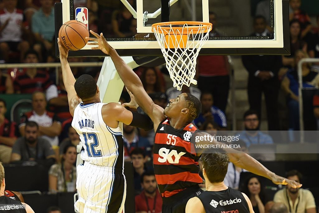 Tobias Harris (12) of the Orlando Magic basketball team vies for the ball with Flamengo's Jerome Meyensse during the NBA Global Games Rio2015 at the HSBC Arena in Rio de Janeiro on 17 October, 2015.