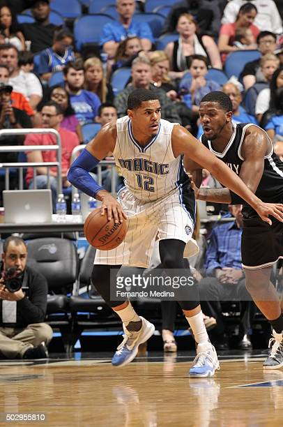 Tobias Harris of the Orlando Magic defends the ball against the Brooklyn Nets during the game on December 30 2015 at Amway Center in Orlando Florida...