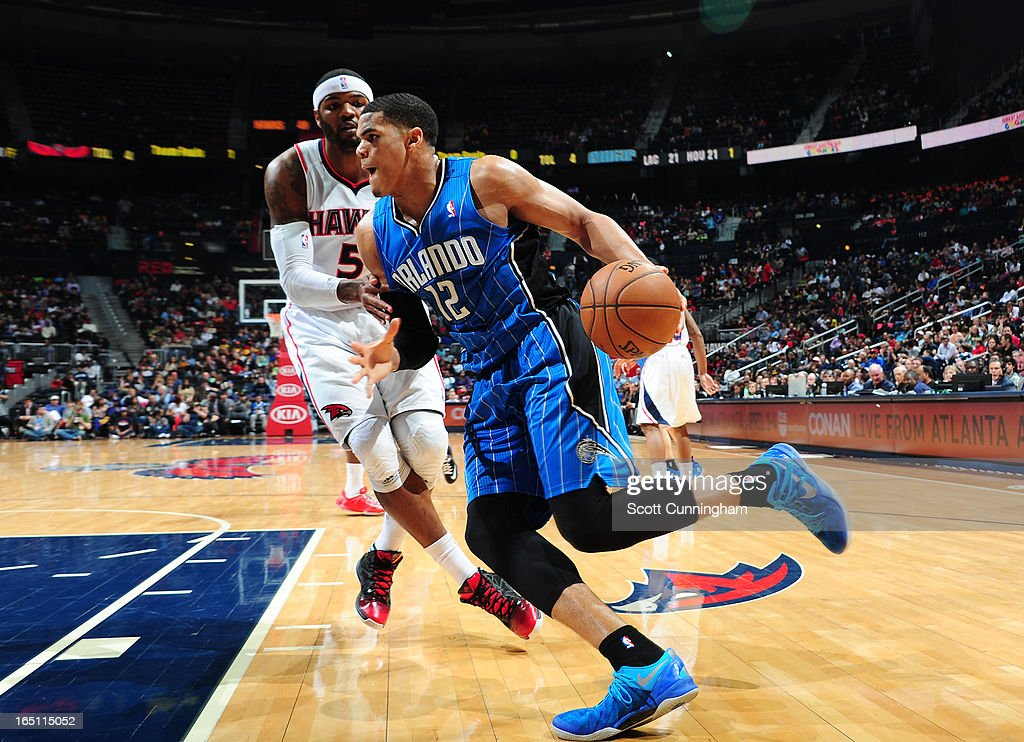 Tobias Harris #12 of the Orlando Magic drives baseline against Josh Smith #5 of the Atlanta Hawks on March 30, 2013 at Philips Arena in Atlanta, Georgia.