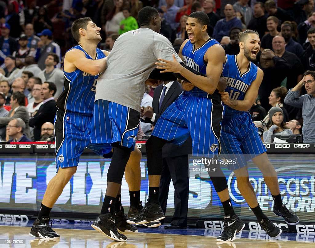 Tobias Harris #12 of the Orlando Magic reacts with Nikola Vucevic #9 and Evan Fournier #10 after Harris made the game winning jump shot at the buzzer to defeat the Philadelphia 76ers 91-89 on November 5, 2014 at the Wells Fargo Center in Philadelphia, Pennsylvania.