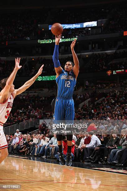Tobias Harris of the Orlando Magic shoots over Mike Dunleavy of the Chicago Bulls on December 16 2013 at the United Center in Chicago Illinois NOTE...