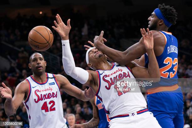 Tobias Harris of the Philadelphia 76ers and Mitchell Robinson of the New York Knicks compete for the ball in the third quarter at the Wells Fargo...