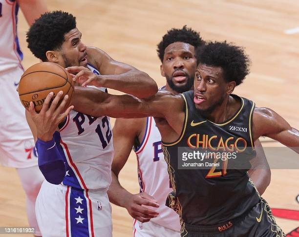 Tobias Harris of the Philadelphia 76ers and Thaddeus Young of the Chicago Bulls battle for a rebound at the United Center on May 03, 2021 in Chicago,...