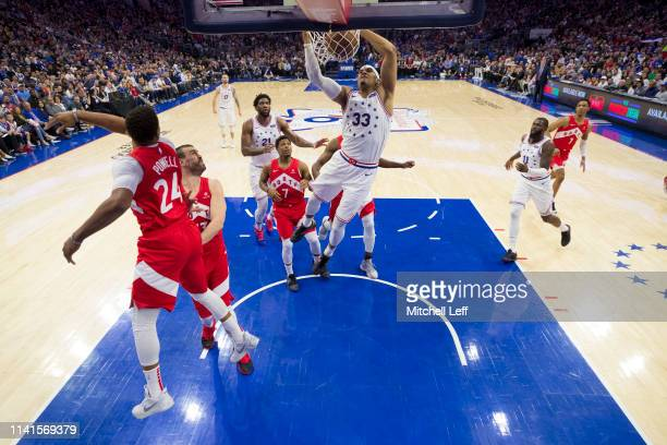 Tobias Harris of the Philadelphia 76ers dunks the ball past Norman Powell of the Toronto Raptors in the second quarter of Game Four of the Eastern...