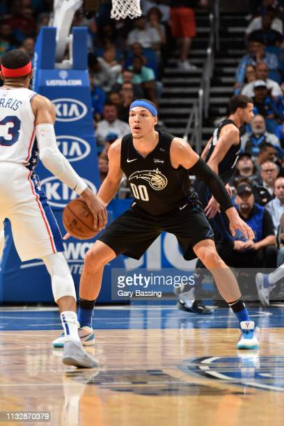 Tobias Harris of the Philadelphia 76ers handles the ball against Aaron Gordon of the Orlando Magic on March 25 2019 at Amway Center in Orlando...
