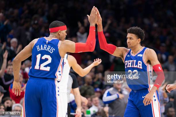 Tobias Harris of the Philadelphia 76ers high fives Matisse Thybulle against the Denver Nuggets in the second quarter at the Wells Fargo Center on...
