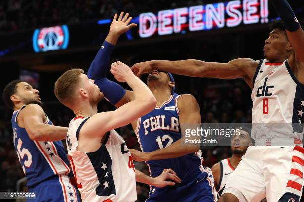 Tobias Harris of the Philadelphia 76ers is hit in the face by Rui Hachimura of the Washington Wizards after shooting during the second half at...