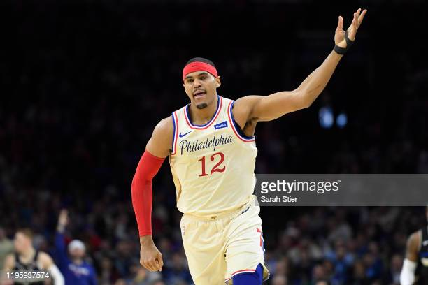 Tobias Harris of the Philadelphia 76ers reacts after making a three-point basket during the first half of the game against the Milwaukee Bucks at...
