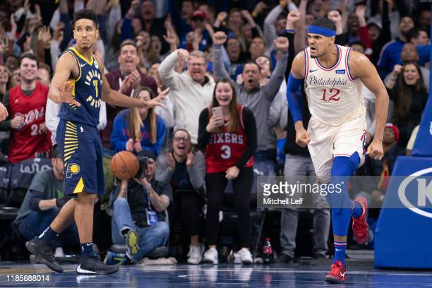 Tobias Harris of the Philadelphia 76ers reacts in front of Malcolm Brogdon of the Indiana Pacers in the fourth quarter at the Wells Fargo Center on...