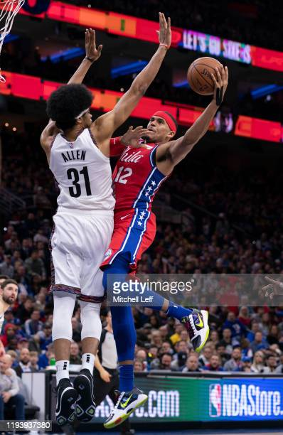 Tobias Harris of the Philadelphia 76ers shoots the ball against Jarrett Allen of the Brooklyn Nets in the fourth quarter at the Wells Fargo Center on...